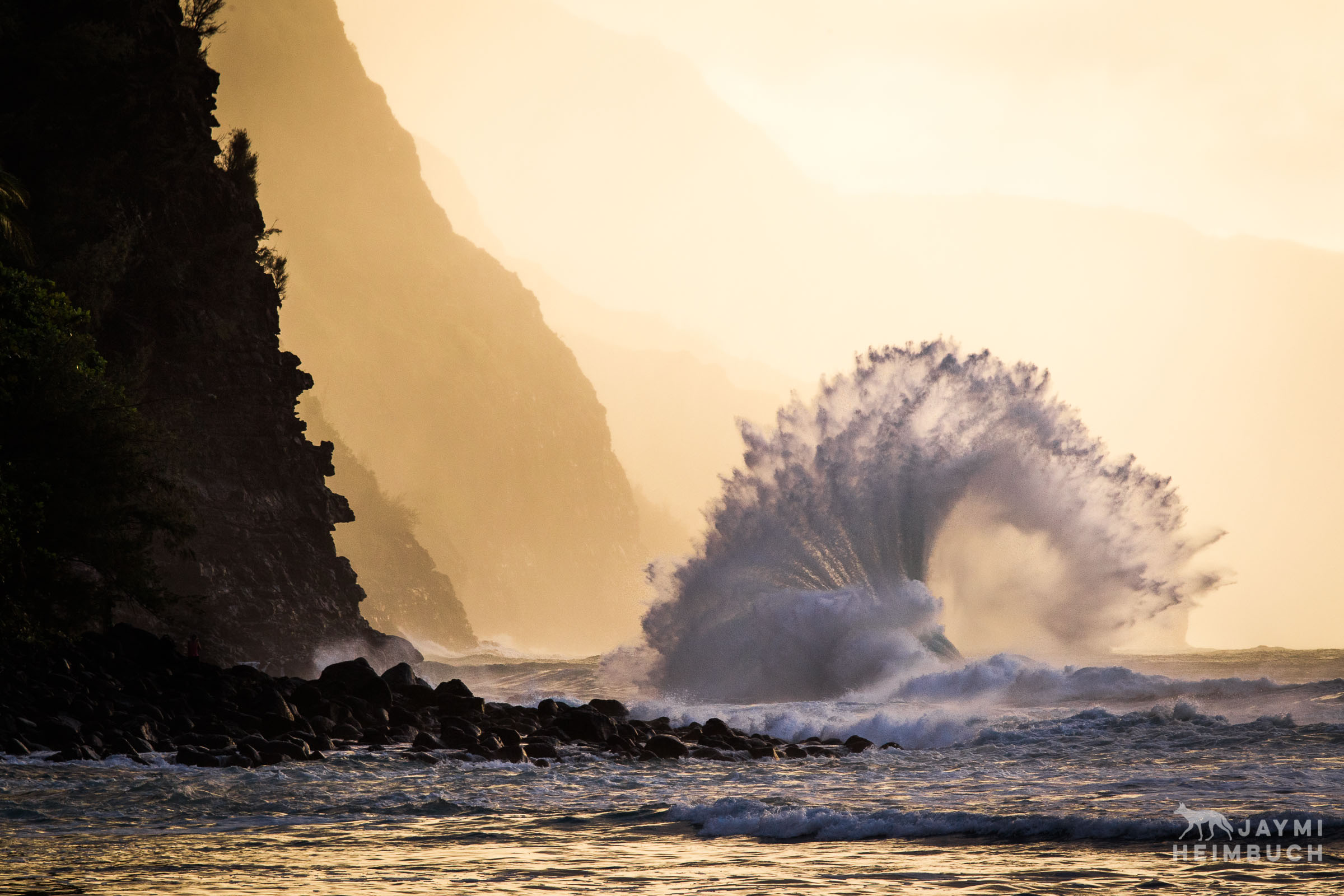 Fan wave crashing on Na Pali shore, Kauai, Hawaii